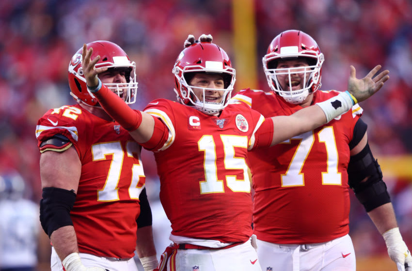 KANSAS CITY, MISSOURI - JANUARY 19: Patrick Mahomes #15 of the Kansas City Chiefs reacts with teammates Eric Fisher #72 and Mitchell Schwartz #71 (Photo by Jamie Squire/Getty Images)