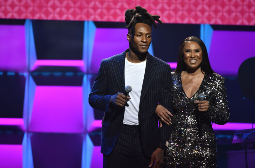 MIAMI, FLORIDA - JANUARY 30: DeAndre Hopkins (L) and Sabrina Greenlee speak onstage during the BET Super Bowl Gospel Celebration at the James L. Knight Center on January 30, 2020 in Miami, Florida. (Photo by Aaron J. Thornton/Getty Images for BET)