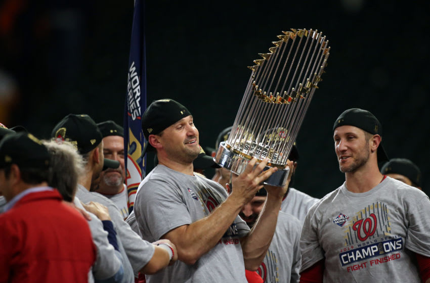 HOUSTON, TX - OCTOBER 30: Ryan Zimmerman #11 of the Washington Nationals celebrates with the Commissioner's Trophy after the Nationals defeated the Houston Astros in Game 7 to win the 2019 World Series at Minute Maid Park on Wednesday, October 30, 2019 in Houston, Texas. (Photo by Cooper Neill/MLB Photos via Getty Images)