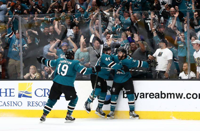 SAN JOSE, CALIFORNIA - APRIL 23: Barclay Goodrow #23 of the San Jose Sharks is congratulated by Marc-Edouard Vlasic #44 and Joe Thornton #19 of the San Jose Sharks after he scored the game winning goal in overtime against the Vegas Golden Knights in Game Seven of the Western Conference First Round during the 2019 NHL Stanley Cup Playoffs at SAP Center on April 23, 2019 in San Jose, California. (Photo by Ezra Shaw/Getty Images)