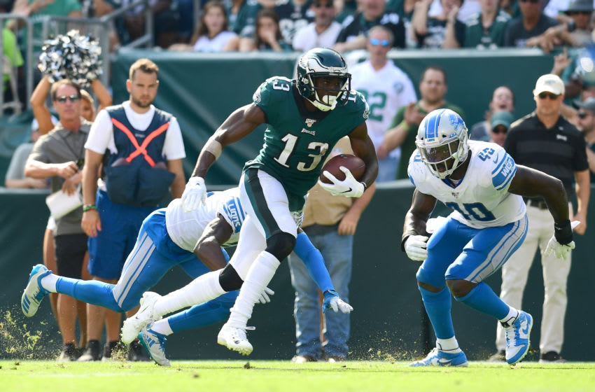 PHILADELPHIA, PENNSYLVANIA - SEPTEMBER 22: Nelson Agholor #13 of the Philadelphia Eagles carries the ball and scores a touchdown during their game against the Detroit Lions at Lincoln Financial Field on September 22, 2019 in Philadelphia, Pennsylvania. The Lions won 27-24. (Photo by Emilee Chinn/Getty Images)