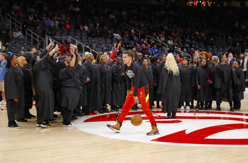 ATLANTA, GA - FEBRUARY 29: Trae Young #11 of the Atlanta Hawks warms up in front of the choir who was set to perform the National Anthem prior to an NBA game against the Portland Trail Blazers at State Farm Arena on February 29, 2020 in Atlanta, Georgia. NOTE TO USER: User expressly acknowledges and agrees that, by downloading and/or using this photograph, user is consenting to the terms and conditions of the Getty Images License Agreement. (Photo by Todd Kirkland/Getty Images)