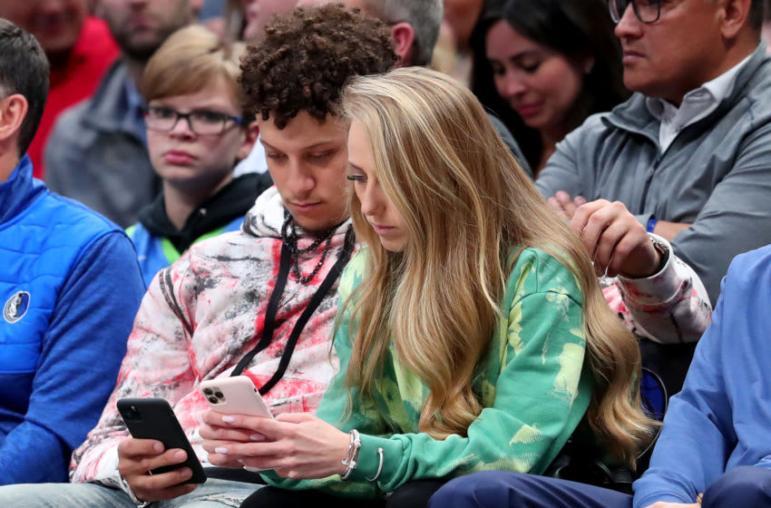DALLAS, TEXAS - MARCH 04: Patrick Mahomes #15 of the Kansas City Chiefs and girlfriend, Brittany Matthews, look on as the Dallas Mavericks take on the New Orleans Pelicans at American Airlines Center on March 04, 2020 in Dallas, Texas. NOTE TO USER: User expressly acknowledges and agrees that, by downloading and or using this photograph, User is consenting to the terms and conditions of the Getty Images License Agreement. (Photo by Tom Pennington/Getty Images)