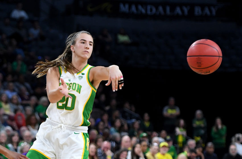 LAS VEGAS, NEVADA - MARCH 08: Sabrina Ionescu #20 of the Oregon Ducks passes against the Stanford Cardinal during the championship game of the Pac-12 Conference women's basketball tournament at the Mandalay Bay Events Center on March 8, 2020 in Las Vegas, Nevada. The Ducks defeated the Cardinal 89-56. (Photo by Ethan Miller/Getty Images)