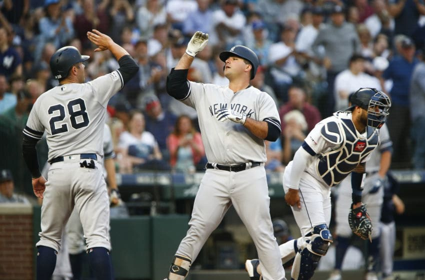 SEATTLE, WA - AUGUST 26: Mike Ford #36 of the New York Yankees high-fives Austin Romine #28 after hitting a two-run home run in the second inning against the Seattle Mariners at T-Mobile Park on August 26, 2019 in Seattle, Washington. (Photo by Lindsey Wasson/Getty Images)