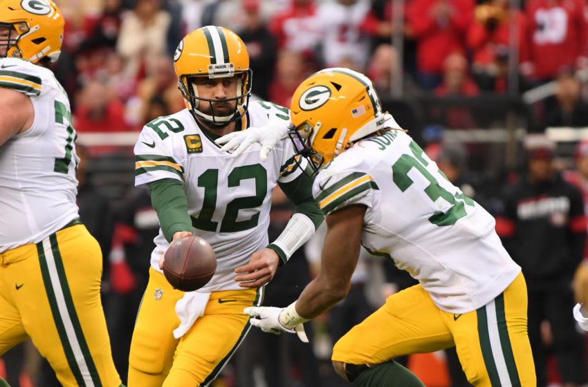 SANTA CLARA, CALIFORNIA - JANUARY 19: Aaron Rodgers #12 of the Green Bay Packers hands off to Aaron Jones #33 in the first half against the San Francisco 49ers during the NFC Championship game at Levi's Stadium on January 19, 2020 in Santa Clara, California. (Photo by Harry How/Getty Images)