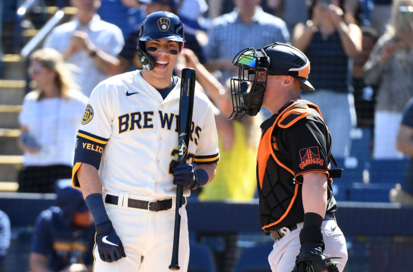 MARYVALE, ARIZONA - MARCH 06: Christian Yelich #22 of the Milwaukee Brewers talks with catcher Tyler Heineman #81 of the San Francisco Giants prior to stepping into the batters box during a spring training game at American Family Fields of Phoenix on March 06, 2020 in Maryvale, Arizona. (Photo by Norm Hall/Getty Images)