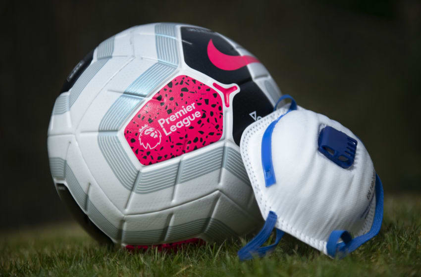MANCHESTER, ENGLAND - APRIL 03: The official Nike Premier League match ball with a protective mask. The Coronavirus (COVID-19) pandemic has spread to many countries across the world, claiming over 40,000 lives and infecting hundreds of thousands more. on April 3, 2020 in Manchester, England (Photo by Visionhaus)