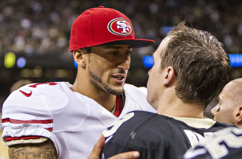 NEW ORLEANS, LA - NOVEMBER 17: Colin Kaepernick #7 of the San Francisco 49ers talks after the game to Dree Brews #9 of the New Orleans Saints at Mercedes-Benz Superdome on November 17, 2013 in New Orleans, Louisiana. The Saints defeated the 49ers 23-20. (Photo by Wesley Hitt/Getty Images)