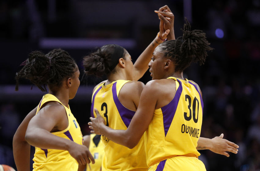LOS ANGELES, CALIFORNIA - AUGUST 01: Forward Nneka Ogwumike #30 of the Los Angeles Sparks celebrates the team's win against the Las Vegas Aces with forward Candace Parker #3 and guard Chelsea Gray #12 at Staples Center on August 01, 2019 in Los Angeles, California. NOTE TO USER: User expressly acknowledges and agrees that, by downloading and or using this photograph, User is consenting to the terms and conditions of the Getty Images License Agreement. (Photo by Meg Oliphant/Getty Images)