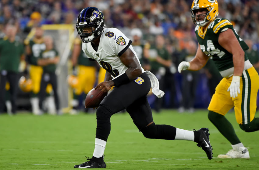 BALTIMORE, MD - AUGUST 15: Lamar Jackson #8 of the Baltimore Ravens runs in front of Dean Lowry #94 of the Green Bay Packers during the first half of a preseason game at M&T Bank Stadium on August 15, 2019 in Baltimore, Maryland. (Photo by Will Newton/Getty Images)