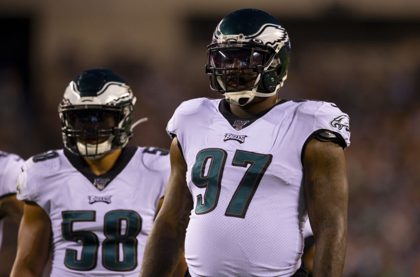 PHILADELPHIA, PA - AUGUST 22: L.J. Fort #58 and Malik Jackson #97 of the Philadelphia Eagles look on against the Baltimore Ravens in the preseason game at Lincoln Financial Field on August 22, 2019 in Philadelphia, Pennsylvania. (Photo by Mitchell Leff/Getty Images)