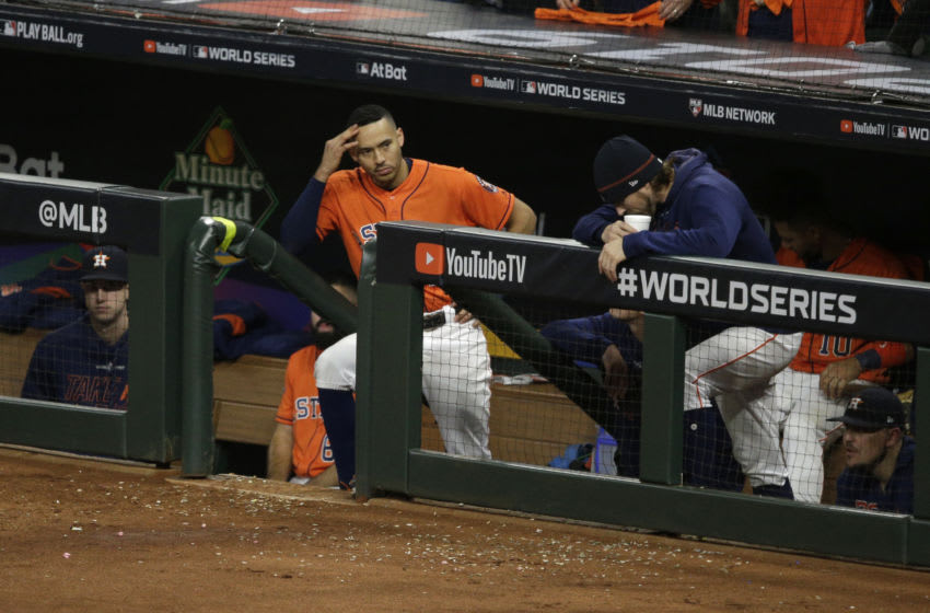 HOUSTON, TEXAS - OCTOBER 30: Carlos Correa #1 of the Houston Astros looks on against the Washington Nationals during the ninth inning in Game Seven of the 2019 World Series at Minute Maid Park on October 30, 2019 in Houston, Texas. (Photo by Bob Levey/Getty Images)