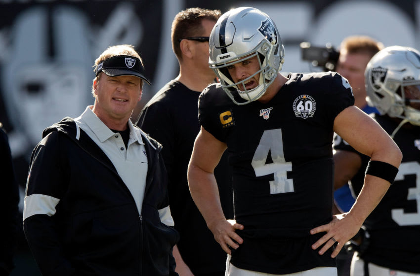 OAKLAND, CA - DECEMBER 15: Head coach Jon Gruden of the Oakland Raiders talks to quarterback Derek Carr #4 before the game against the Jacksonville Jaguars at RingCentral Coliseum on December 15, 2019 in Oakland, California. (Photo by Jason O. Watson/Getty Images)