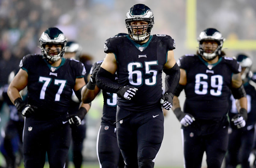 PHILADELPHIA, PENNSYLVANIA - DECEMBER 09: Offensive tackle Lane Johnson #65 of the Philadelphia Eagles and team run on to the field before the game against the New York Giants at Lincoln Financial Field on December 09, 2019 in Philadelphia, Pennsylvania. (Photo by Emilee Chinn/Getty Images)