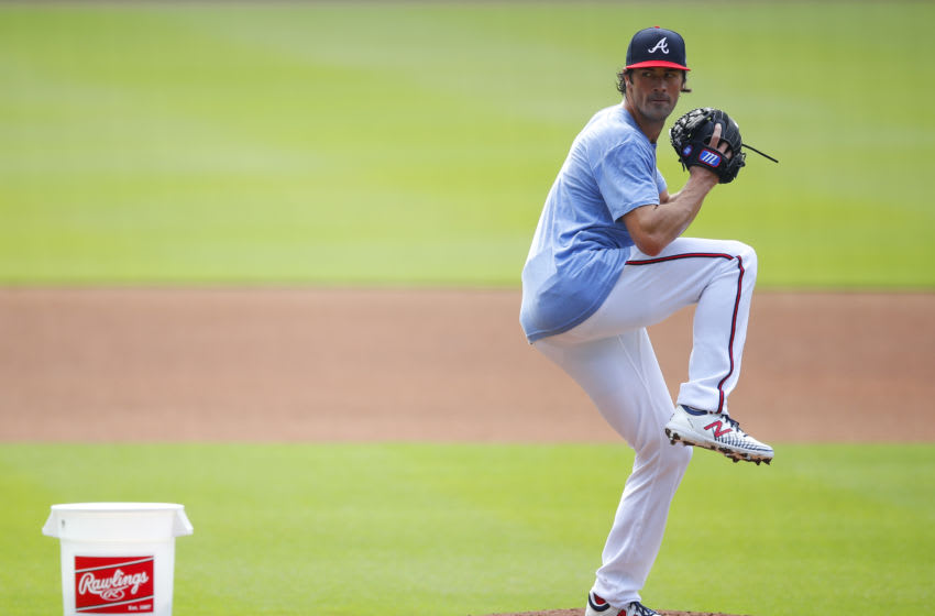 ATLANTA, GA - JULY 03: Cole Hamels #32 of the Atlanta Braves pitches during the first day of Summer workouts at Truist Park on July 3, 2020 in Atlanta, Georgia. (Photo by Todd Kirkland/Getty Images)