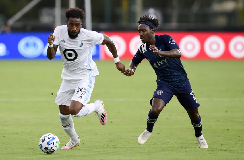 REUNION, FLORIDA - JULY 12: Romain Metanire #19 of Minnesota United runs the ball past Gerso #12 of Sporting Kansas City in the first half during a match in the MLS Is Back Tournament at ESPN Wide World of Sports Complex on July 12, 2020 in Reunion, Florida. Minnesota United won 2-1. (Photo by Emilee Chinn/Getty Images)