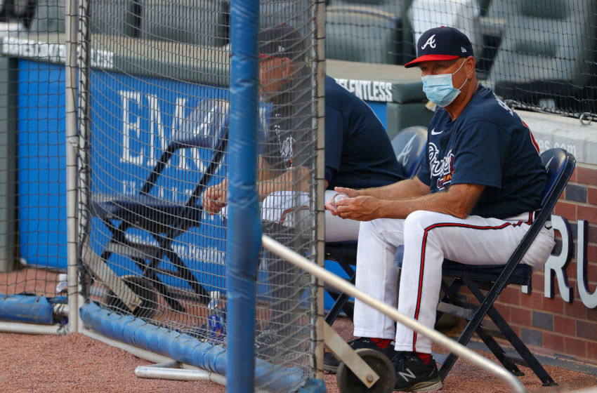 ATLANTA, GEORGIA - JULY 13: Manager Brian Snitker #43 of the Atlanta Braves looks on during the first intrasquad game of summer workouts at Truist Park on July 13, 2020 in Atlanta, Georgia. (Photo by Kevin C. Cox/Getty Images)