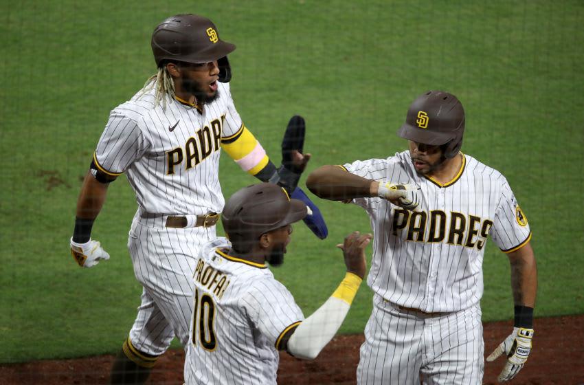 Tommy Pham, Jurickson Profar, Fernando Tatis, Jr., San Diego Padres. (Photo by Sean M. Haffey/Getty Images)
