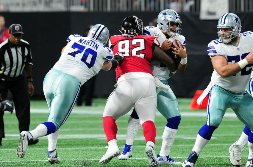 ATLANTA, GA - NOVEMBER 12: Dak Prescott #4 of the Dallas Cowboys is sacked by Dontari Poe #92 of the Atlanta Falcons aat Mercedes-Benz Stadium on November 12, 2017 in Atlanta, Georgia. (Photo by Scott Cunningham/Getty Images)
