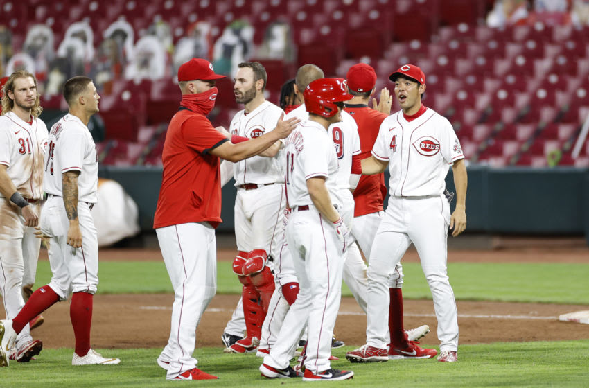 Joey Votto #19 of the Cincinnati Reds celebrates with Shogo Akiyama #4 after hitting the game-winning double off the centerfield wall in the 10th inning against the Kansas City Royals at Great American Ball Park on August 11, 2020 in Cincinnati, Ohio. The Reds won 6-5. (Photo by Joe Robbins/Getty Images)
