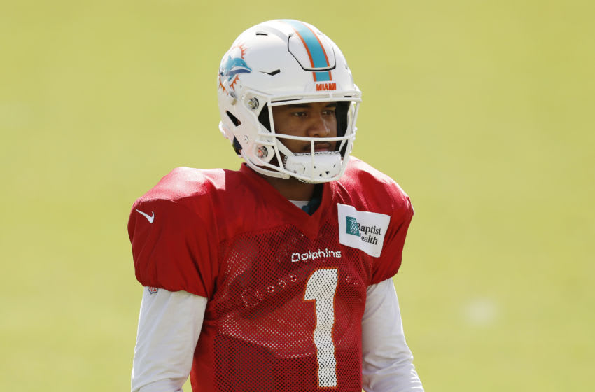 DAVIE, FLORIDA - AUGUST 18: Tua Tagovailoa #1 of the Miami Dolphins looks on during training camp at Baptist Health Training Facility at Nova Southern University on August 18, 2020 in Davie, Florida. (Photo by Michael Reaves/Getty Images)
