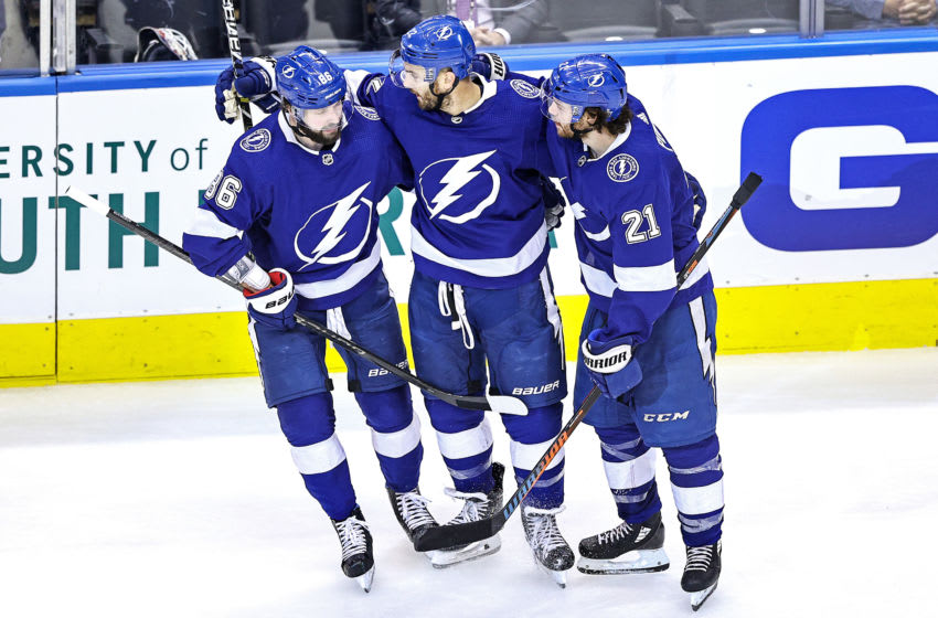 TORONTO, ONTARIO - AUGUST 19: Kevin Shattenkirk #22 of the Tampa Bay Lightning is congratulated by his teammates, Nikita Kucherov #86 and Brayden Point #21 after scoring a goal against the Columbus Blue Jackets at 12:01 during the third period in Game Five of the Eastern Conference First Round during the 2020 NHL Stanley Cup Playoffs at Scotiabank Arena on August 19, 2020 in Toronto, Ontario. (Photo by Elsa/Getty Images)