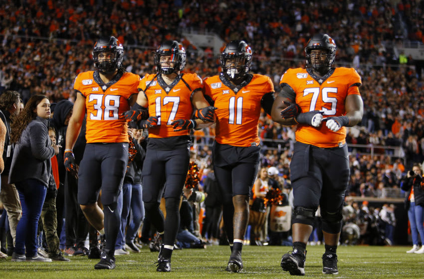 STILLWATER, OK - NOVEMBER 30: The Oklahoma State Cowboys captains, linebacker Philip Redwine-Bryant #38, wide receiver Dillon Stoner #17, linebacker Amen Ogbongbemiga #11, and offensive lineman Marcus Keyes #75, head onto the field for a Bedlam game against the Oklahoma Sooners on November 30, 2019 at Boone Pickens Stadium in Stillwater, Oklahoma. OU won 34-16. (Photo by Brian Bahr/Getty Images)