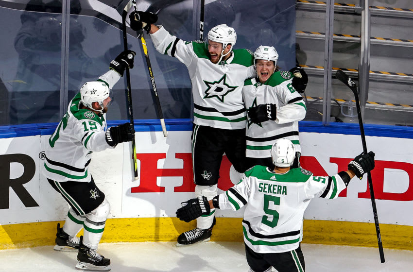 Joel Kiviranta #25 of the Dallas Stars is congratulated by his teammates after scoring the game-winning goal against the Colorado Avalanche during the first overtime period to win Game Seven of the Western Conference Second Round during the 2020 NHL Stanley Cup Playoffs at Rogers Place on September 04, 2020 in Edmonton, Alberta, Canada. (Photo by Bruce Bennett/Getty Images)