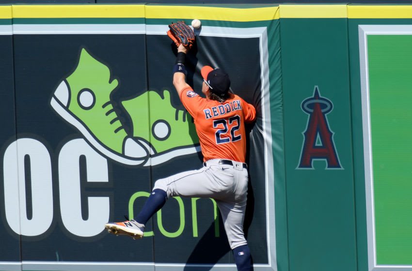 ANAHEIM, CALIFORNIA - SEPTEMBER 06: Josh Reddick #22 of the Houston Astros misses a catch on a triple from Taylor Ward #3 of the Los Angeles Angels during the sixth inning at Angel Stadium of Anaheim on September 06, 2020 in Anaheim, California. (Photo by Harry How/Getty Images)