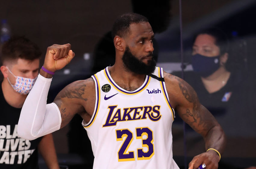 LeBron James of the Los Angeles Lakers reacts during the fourth quarter against the Houston Rockets in Game Three of the Western Conference Second Round during the 2020 NBA Playoffs at AdventHealth Arena at the ESPN Wide World Of Sports Complex on September 08, 2020 in Lake Buena Vista, Florida. NOTE TO USER: User expressly acknowledges and agrees that, by downloading and or using this photograph, User is consenting to the terms and conditions of the Getty Images License Agreement. (Photo by Mike Ehrmann/Getty Images)