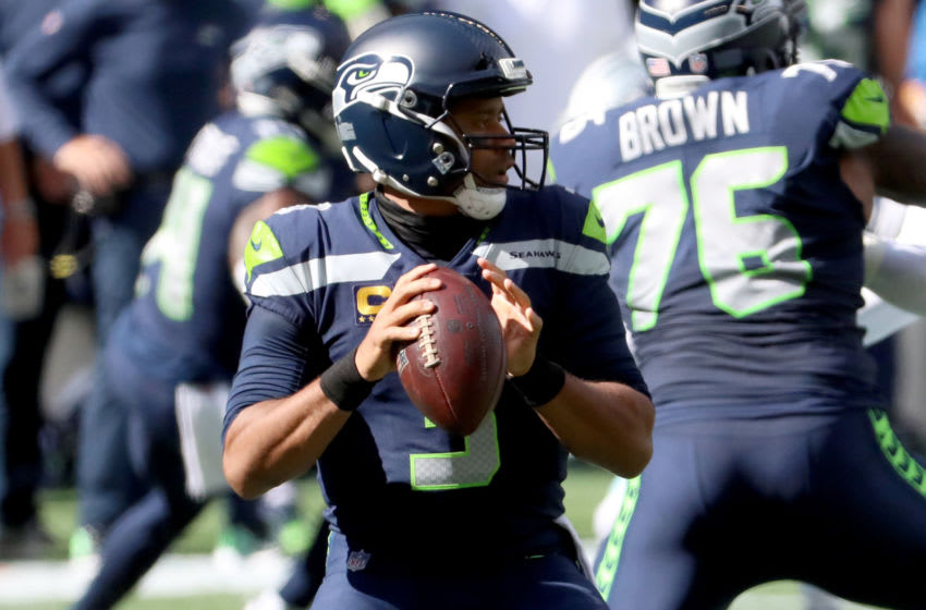 SEATTLE, WASHINGTON - SEPTEMBER 27: Russell Wilson #3 of the Seattle Seahawks looks to throw a pass against the Dallas Cowboys during the first quarter in the game at CenturyLink Field on September 27, 2020 in Seattle, Washington. (Photo by Abbie Parr/Getty Images)