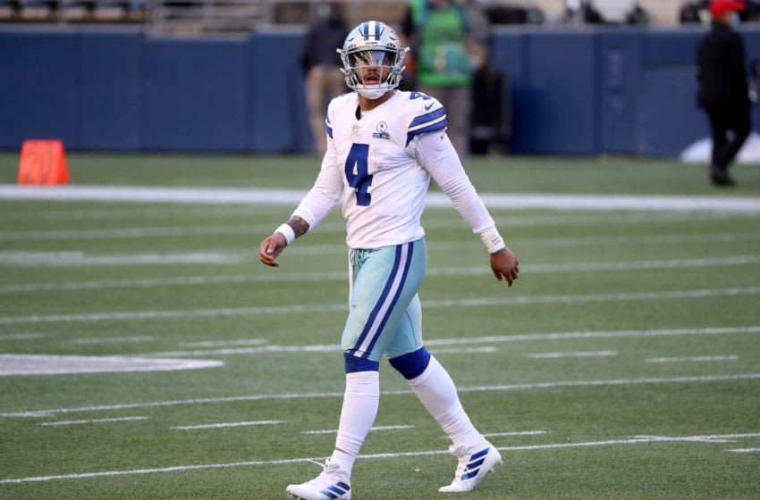 SEATTLE, WASHINGTON - SEPTEMBER 27: Dak Prescott #4 of the Dallas Cowboys reacts after throwing an interception to Ryan Neal #35 of the Seattle Seahawks during the fourth quarter in the game at CenturyLink Field on September 27, 2020 in Seattle, Washington. (Photo by Abbie Parr/Getty Images)