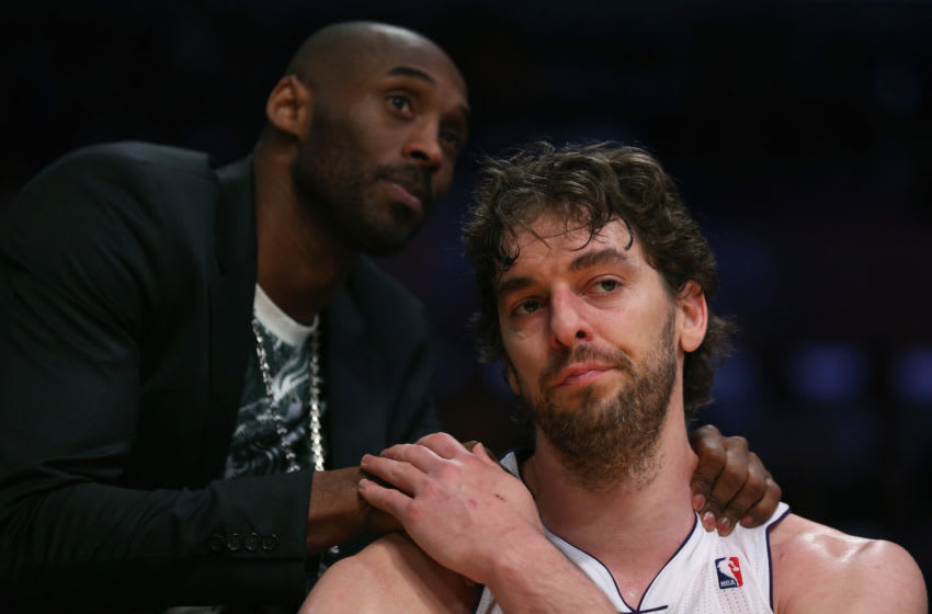LOS ANGELES, CA - APRIL 28: Pau Gasol #16 of the Los Angeles Lakers is consoled by Kobe Bryant after coming out of the game in the second half against the San Antonio Spurs during Game Four of the Western Conference Quarterfinals of the 2013 NBA Playoffs at Staples Center on April 28, 2013 in Los Angeles, California. The Spurs defeated the Lakers 103-82. NOTE TO USER: User expressly acknowledges and agrees that, by downloading and or using this photograph, User is consenting to the terms and conditions of the Getty Images License Agreement. (Photo by Jeff Gross/Getty Images)thx