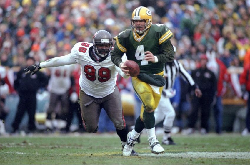 4 Jan 1998: Defensive end Warren Sapp #99 of the Tampa Bay Buccaneers chases quarterback Brett Favre #4 of the Green Bay Packers during the Packers 21-7 win at Lambeau Field in Green Bay, Wisconsin. Mandatory Credit: Matthew Stockman /Allsport