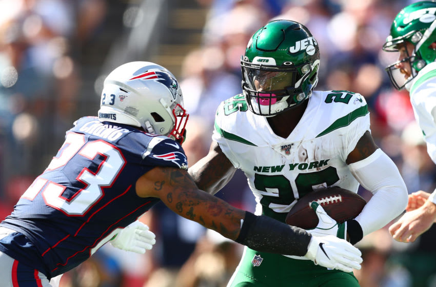 FOXBOROUGH, MASSACHUSETTS - SEPTEMBER 22: Patrick Chung #23 of the New England Patriots attempts to tackle Le'Veon Bell #26 of the New York Jets (Photo by Adam Glanzman/Getty Images)