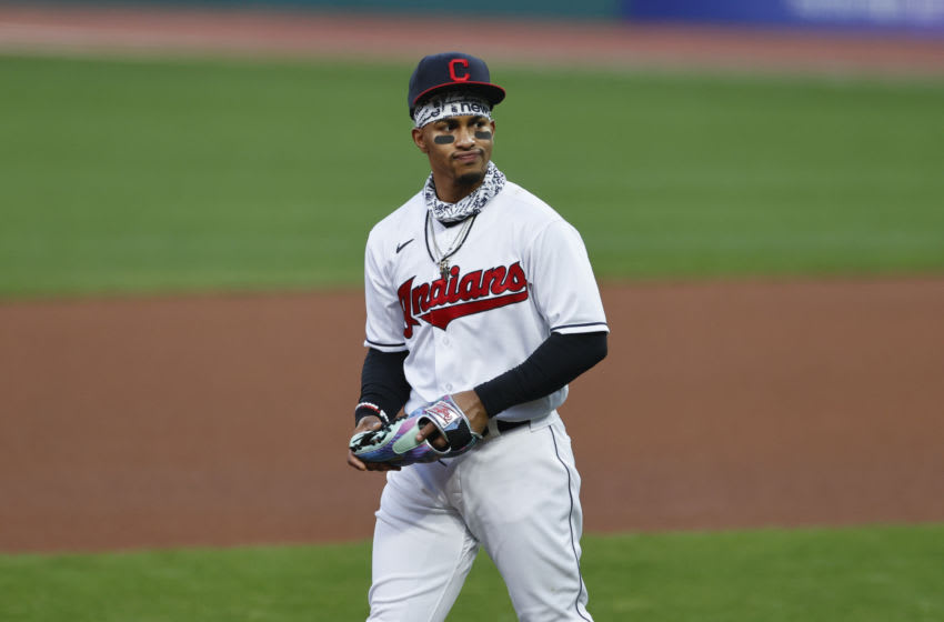CLEVELAND, OH - SEPTEMBER 24: Francisco Lindor #12 of the Cleveland Indians warms up during the fourth inning against the Chicago White Sox at Progressive Field on September 24, 2020 in Cleveland, Ohio. (Photo by Ron Schwane/Getty Images)