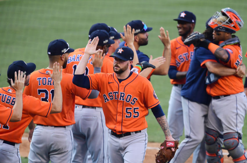 LOS ANGELES, CALIFORNIA - OCTOBER 06: Ryan Pressly #55 of the Houston Astros celebrates a 5-2 in against the Oakland Athletics in Game Two of the American League Division Series at Dodger Stadium on October 06, 2020 in Los Angeles, California. (Photo by Harry How/Getty Images)