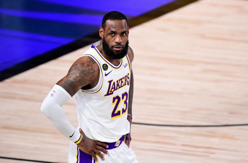 LAKE BUENA VISTA, FLORIDA - OCTOBER 11: LeBron James #23 of the Los Angeles Lakers reacts during the second quarter against the Miami Heat in Game Six of the 2020 NBA Finals at AdventHealth Arena at the ESPN Wide World Of Sports Complex on October 11, 2020 in Lake Buena Vista, Florida. NOTE TO USER: User expressly acknowledges and agrees that, by downloading and or using this photograph, User is consenting to the terms and conditions of the Getty Images License Agreement. (Photo by Douglas P. DeFelice/Getty Images)