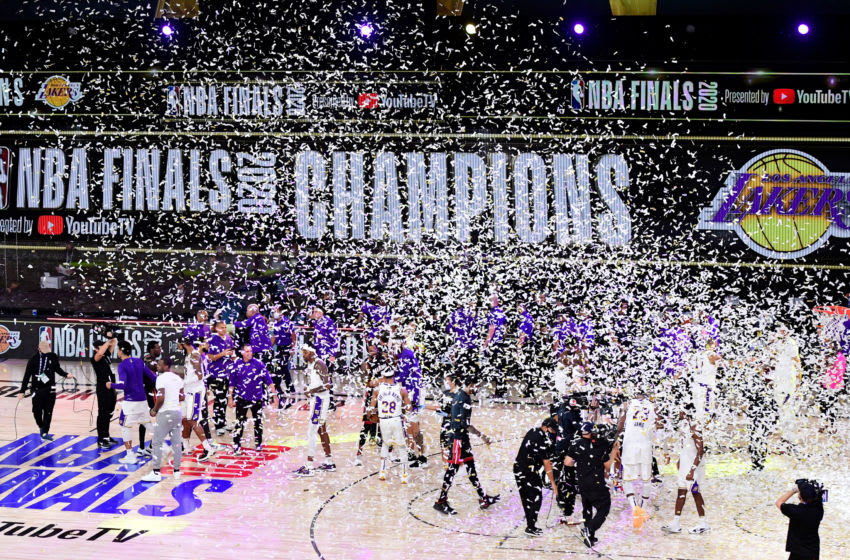 LAKE BUENA VISTA, FLORIDA - OCTOBER 11: The Los Angeles Lakers celebrate with the trophy after winning the 2020 NBA Championship Final over the Miami Heat in Game Six of the 2020 NBA Finals at AdventHealth Arena at the ESPN Wide World Of Sports Complex on October 11, 2020 in Lake Buena Vista, Florida. NOTE TO USER: User expressly acknowledges and agrees that, by downloading and or using this photograph, User is consenting to the terms and conditions of the Getty Images License Agreement. (Photo by Douglas P. DeFelice/Getty Images)