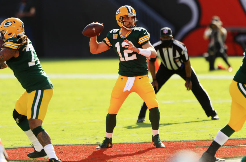 TAMPA, FLORIDA - OCTOBER 18: Aaron Rodgers #12 of the Green Bay Packers throws against the Tampa Bay Buccaneers during the first quarter at Raymond James Stadium on October 18, 2020 in Tampa, Florida. (Photo by Mike Ehrmann/Getty Images)