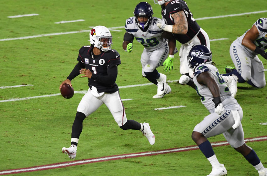 GLENDALE, ARIZONA - OCTOBER 25: Kyler Murray #1 of the Arizona Cardinals looks to throw the ball while under pressure during the first quarter of a game against the Seattle Seahawks at State Farm Stadium on October 25, 2020 in Glendale, Arizona. (Photo by Norm Hall/Getty Images)