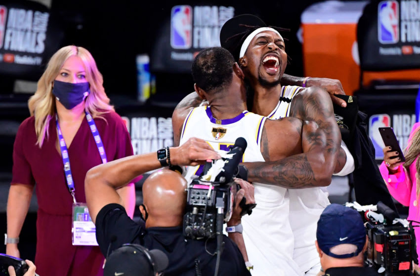 LAKE BUENA VISTA, FLORIDA - OCTOBER 11: LeBron James #23 of the Los Angeles Lakers celebrates with Dwight Howard #39 of the Los Angeles Lakers after winning the 2020 NBA Championship in Game Six of the 2020 NBA Finals at AdventHealth Arena at the ESPN Wide World Of Sports Complex on October 11, 2020 in Lake Buena Vista, Florida. NOTE TO USER: User expressly acknowledges and agrees that, by downloading and or using this photograph, User is consenting to the terms and conditions of the Getty Images License Agreement. (Photo by Douglas P. DeFelice/Getty Images)