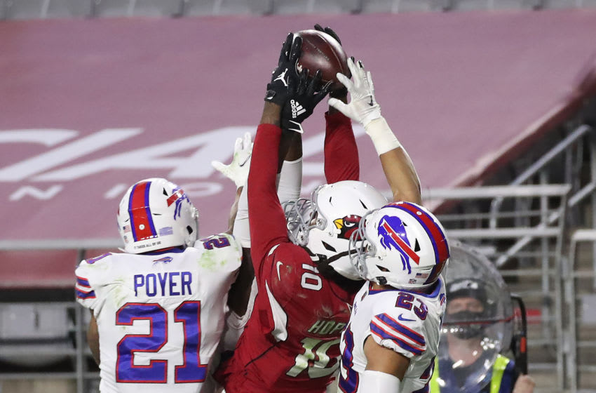 GLENDALE, ARIZONA - NOVEMBER 15: Wide receiver DeAndre Hopkins #10 of the Arizona Cardinals catches the game-winning touchdown pass as safety Jordan Poyer #21 and safety Micah Hyde #23 of the Buffalo Bills defend during the final seconds of the fourth quarter at State Farm Stadium on November 15, 2020 in Glendale, Arizona. (Photo by Christian Petersen/Getty Images)