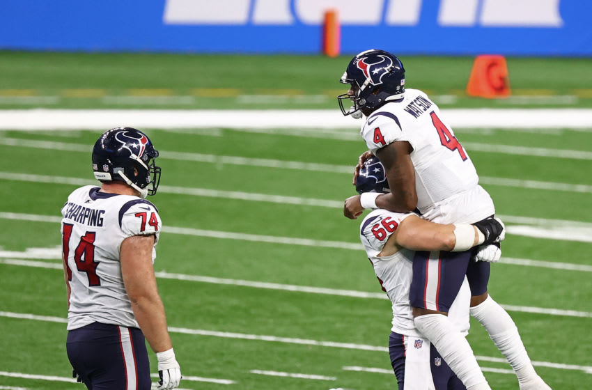 DETROIT, MICHIGAN - NOVEMBER 26: Deshaun Watson #4 of the Houston Texans celebrates a touchdown Nick Martin #66 during the second half of a game against the Detroit Lions at Ford Field on November 26, 2020 in Detroit, Michigan. (Photo by Rey Del Rio/Getty Images)