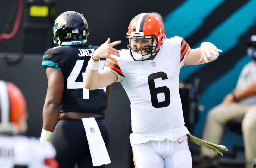 JACKSONVILLE, FLORIDA - NOVEMBER 29: Baker Mayfield #6 of the Cleveland Browns celebrates a first quarter touchdown against the Jacksonville Jaguars at TIAA Bank Field on November 29, 2020 in Jacksonville, Florida. (Photo by Julio Aguilar/Getty Images)