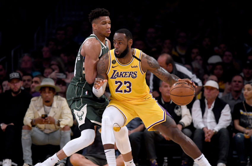 LOS ANGELES, CALIFORNIA - MARCH 06: LeBron James #23 of the Los Angeles Lakers backs in on Giannis Antetokounmpo #34 of the Milwaukee Bucks (Photo by Harry How/Getty Images)