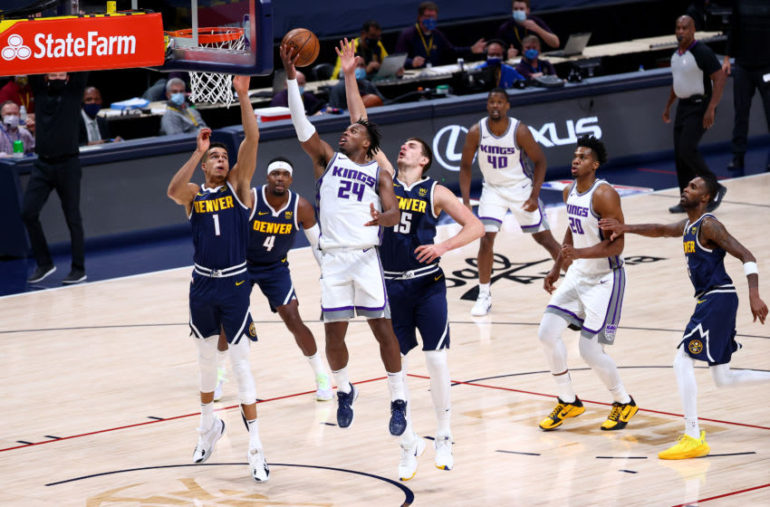 DENVER, CO - DECEMBER 23: Buddy Hield #24 of the Sacramento Kings drives to the basket against Nikola Jokic #15 of the Denver Nuggets (Photo by Jamie Schwaberow/Getty Images)