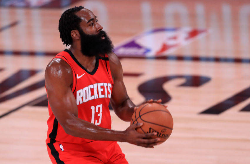 LAKE BUENA VISTA, FLORIDA - AUGUST 31: James Harden #13 of the Houston Rockets shoots the ball against the Oklahoma City Thunder during the first quarter in Game Six of the Western Conference First Round during the 2020 NBA Playoffs at AdventHealth Arena at ESPN Wide World Of Sports Complex on August 31, 2020 in Lake Buena Vista, Florida. NOTE TO USER: User expressly acknowledges and agrees that, by downloading and or using this photograph, User is consenting to the terms and conditions of the Getty Images License Agreement. (Photo by Mike Ehrmann/Getty Images)