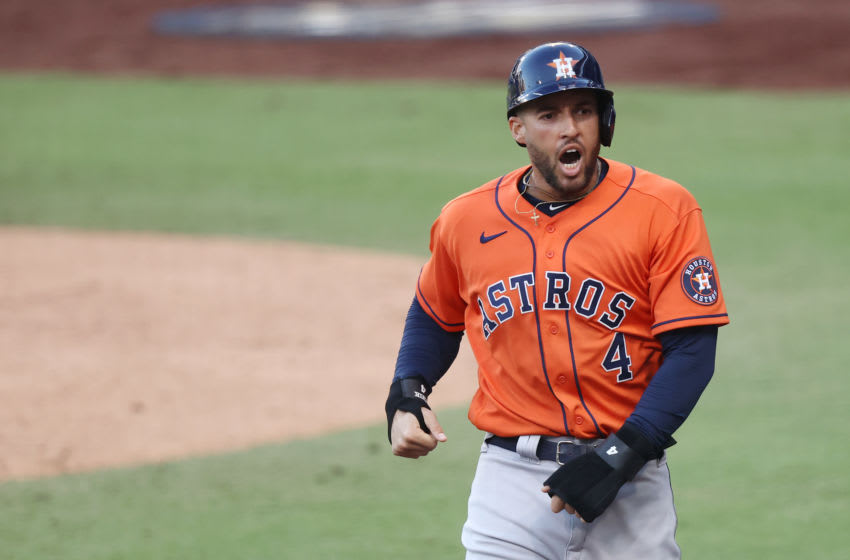 SAN DIEGO, CALIFORNIA - OCTOBER 16: George Springer #4 of the Houston Astros celebrates scoring on a Jose Altuve #27 RBI double during the fifth inning against the Tampa Bay Rays in Game Six of the American League Championship Series at PETCO Park on October 16, 2020 in San Diego, California. (Photo by Ezra Shaw/Getty Images)